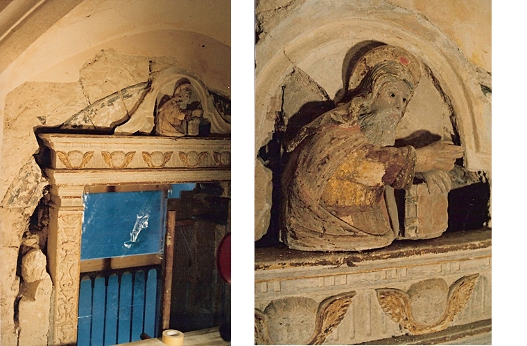 Discovered after removing 18th century masonry that surrounded this chapel window, polychrome gilded wood statue with glass eyes and painted Medieval stone arch (13th century). Note a marble bust randomly used as filler (left).<br />San Pietro in Caveoso, Matera, Italy.