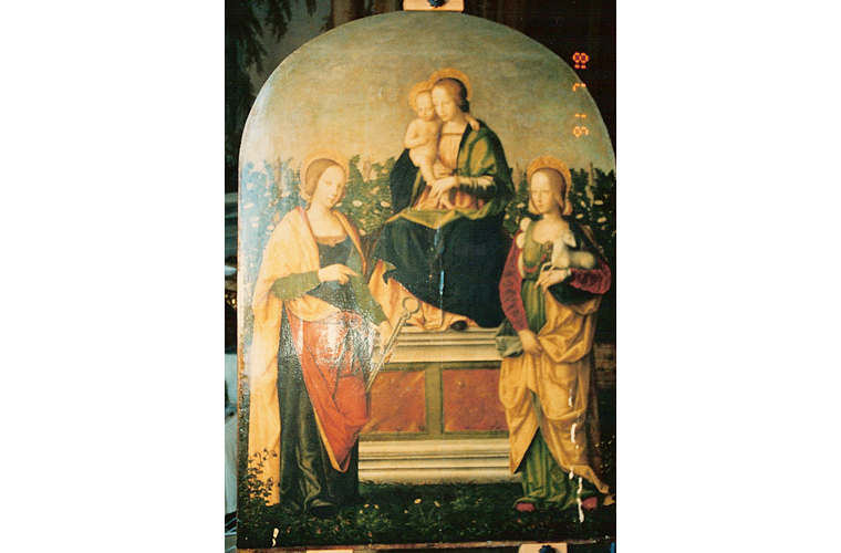 """Saints Agatha and Agnes with Madonna and Child"" before cleaning and discovering angel. 15th century wooden altarpiece. Note paint loss and altered varnish.<br />Palazzo Colonna, Rome, Italy"